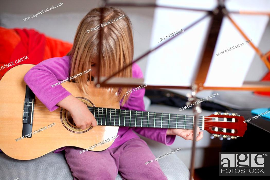 Stock Photo: Girl rehearsing with guitar.
