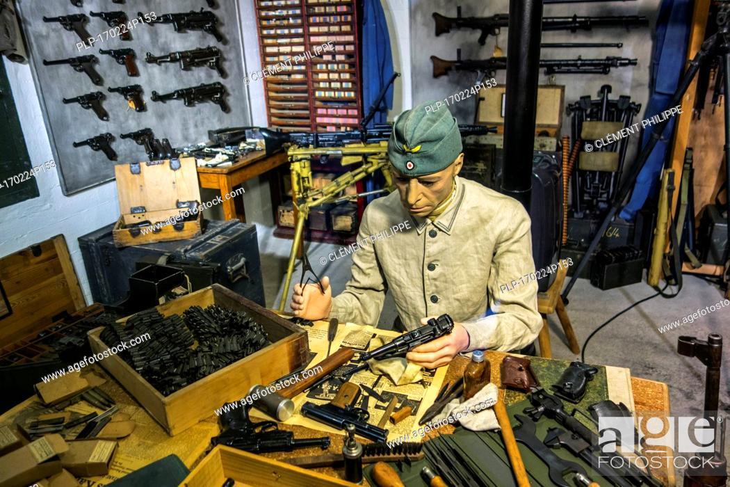 Stock Photo: Diorama showing German WWII gunsmith repairing guns at arsenal, Raversyde Atlantikwall / Atlantic Wall open-air museum at Raversijde, Belgium.