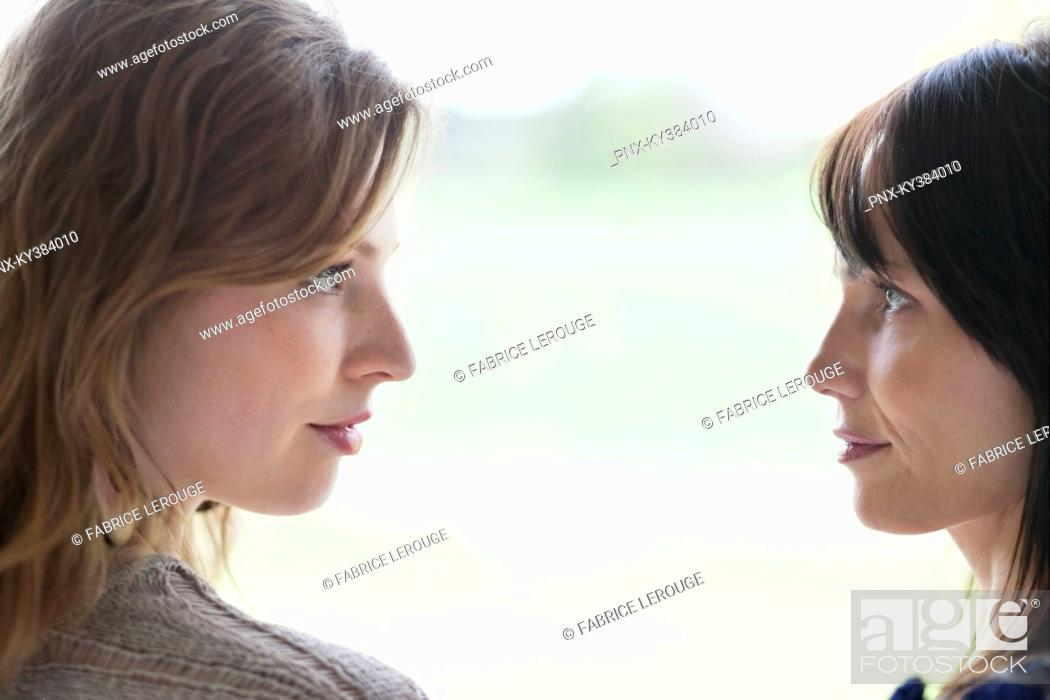 Stock Photo: Woman and her mother face to face.