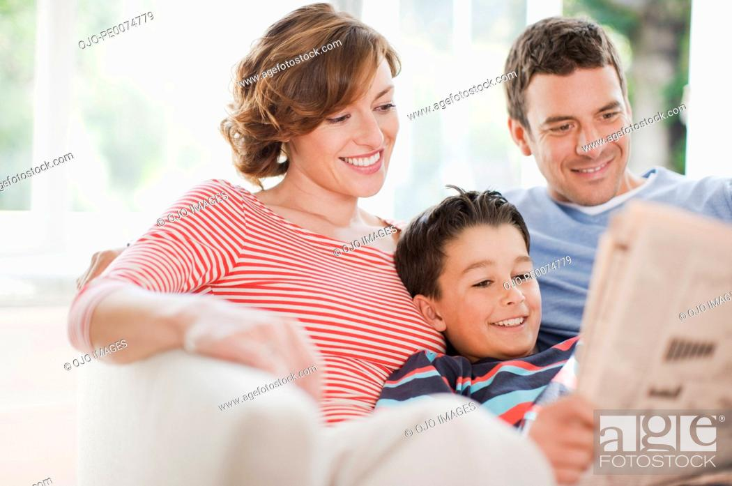 Stock Photo: Family reading newspaper together.