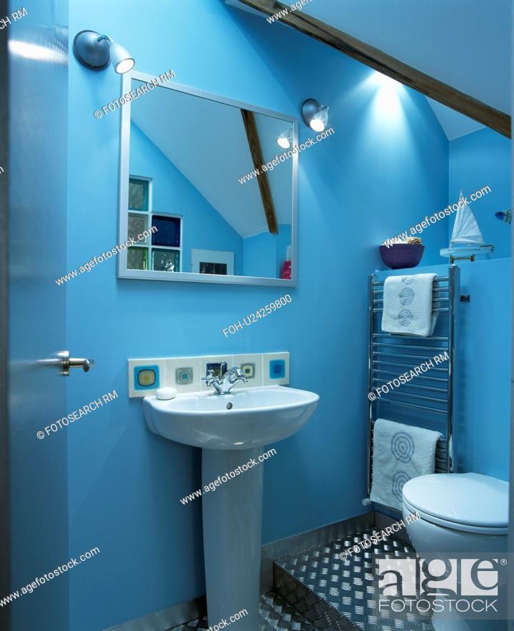 Stock Photo Mirror Above Pedestal Basin In Modern Blue Attic Bathroom