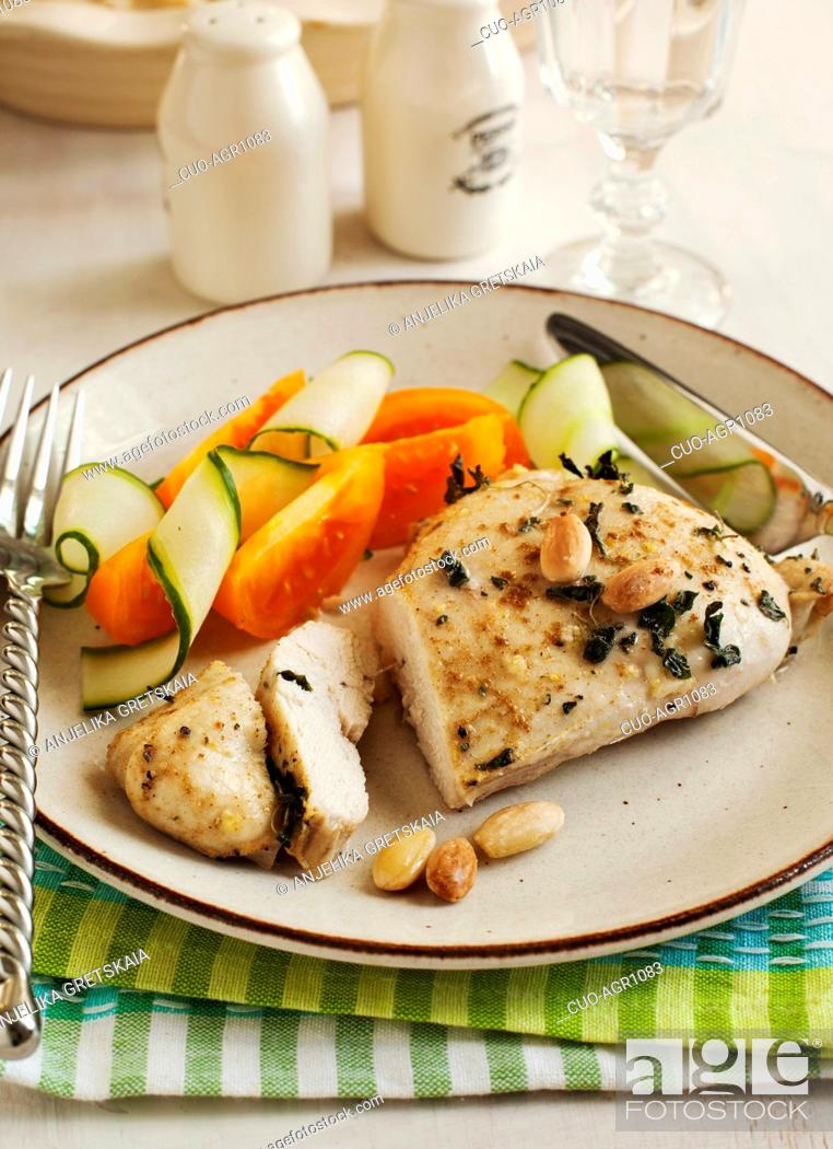Stock Photo: Almond roasted chicken and fresh vegetables.