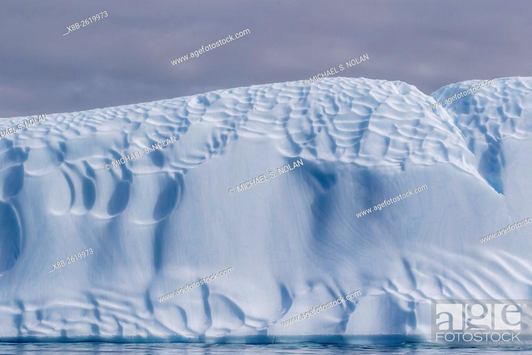 Stock Photo: Sculpted iceberg at Booth Island, Antarctica.