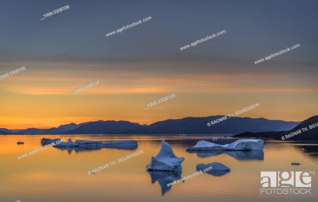 Stock Photo: Icebergs at sunset, Narsaq, Greenland.