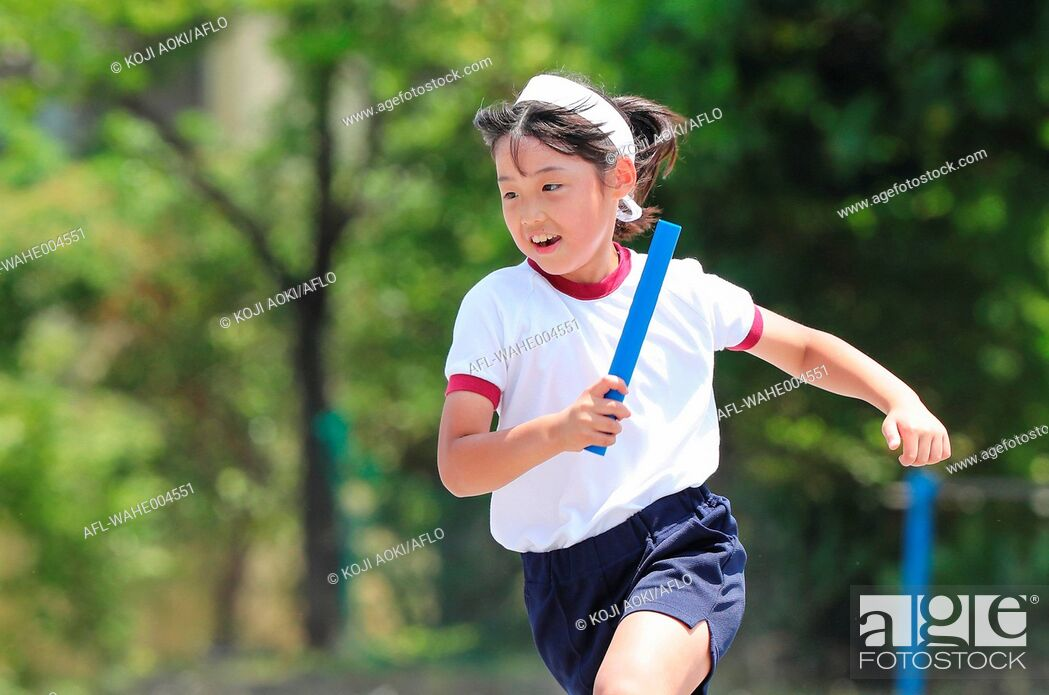 Stock Photo: Japanese kid during school sports day.