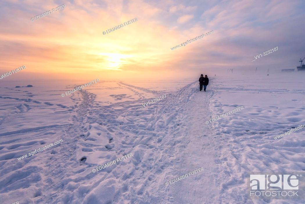 Stock Photo: Frozen Baltic sea with snow in winter and sunset at St Petersburg, Russia.