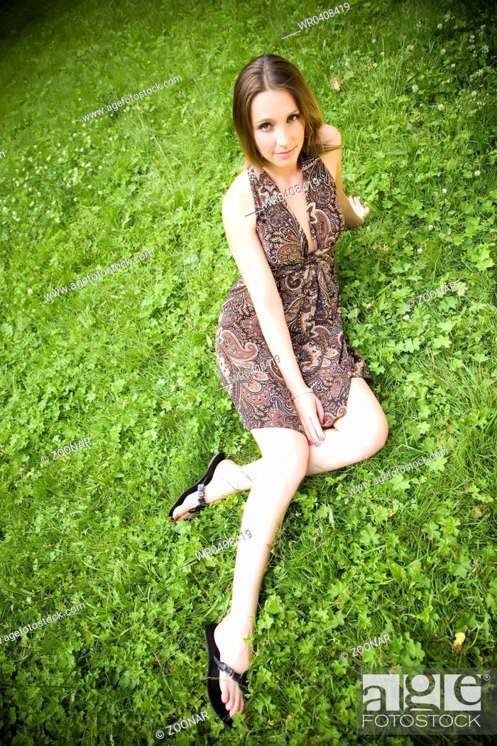 Stock Photo: Woman On The Meadow.