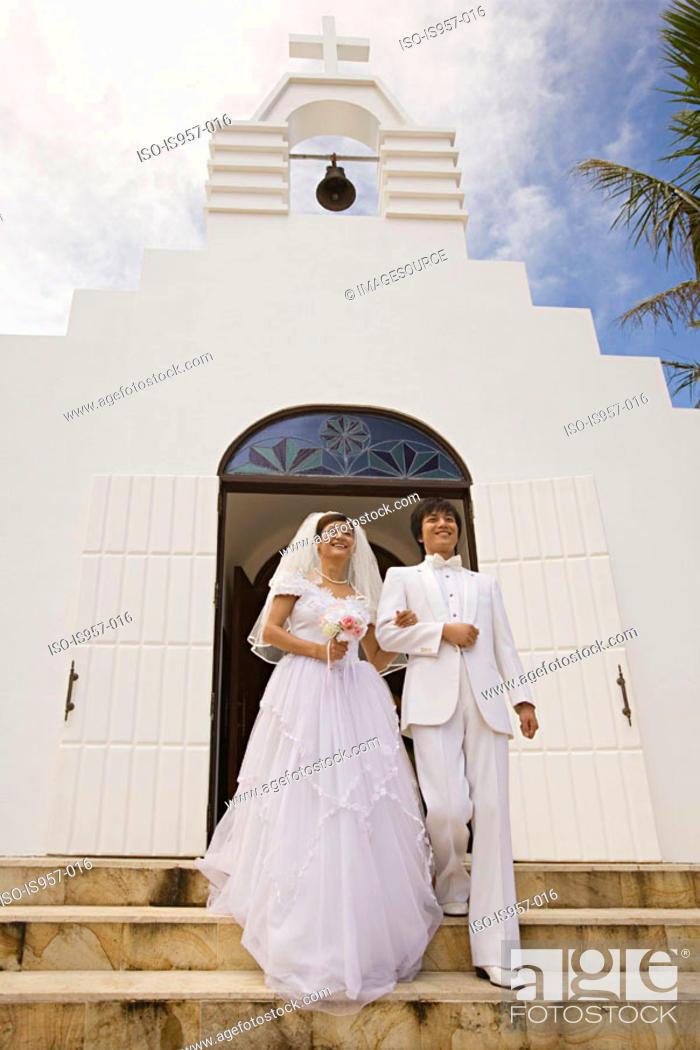 Stock Photo: Newlyweds on church steps.