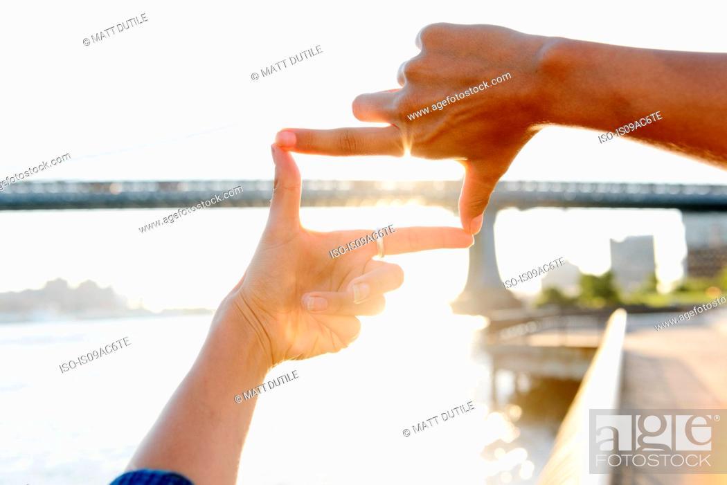Woman\'s fingers framing Manhattan Bridge, Brooklyn, USA, Stock Photo ...