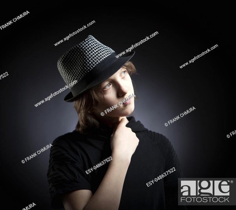 Stock Photo: Portrait of a Boy with Blond Hair in Hat and Black Top.
