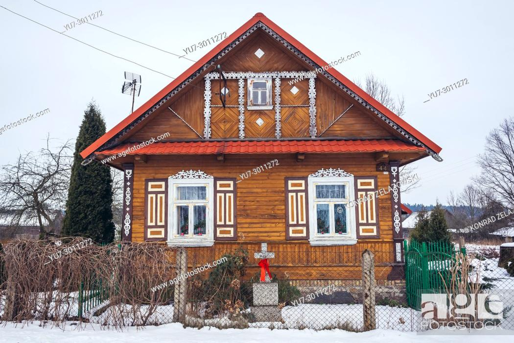 Stock Photo: Wooden house in Soce village on so called The Land of Open Shutters trail, famous for traditional architecture in Podlaskie Voivodeship of Poland.