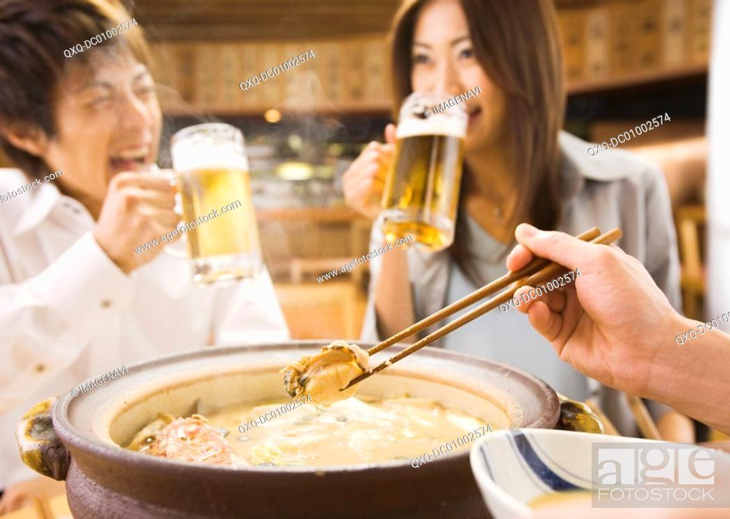 Stock Photo: Group of Young People Enjoying Drinks.
