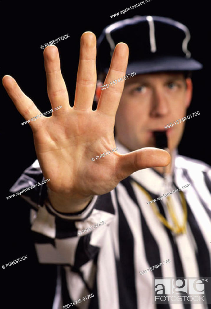 Stock Photo: Portrait of a referee blowing a whistle.