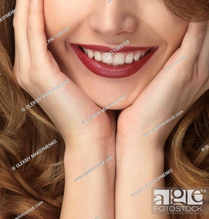 Stock Photo: Closeup portrait of a young woman with a beautiful natural smile.