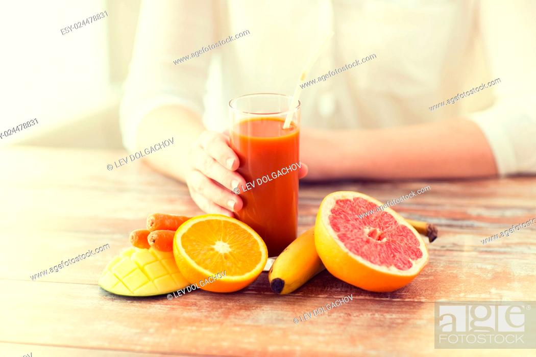 Stock Photo: healthy eating, food, dieting and people concept - close up of woman hands with fruits and fresh juice sitting at table.