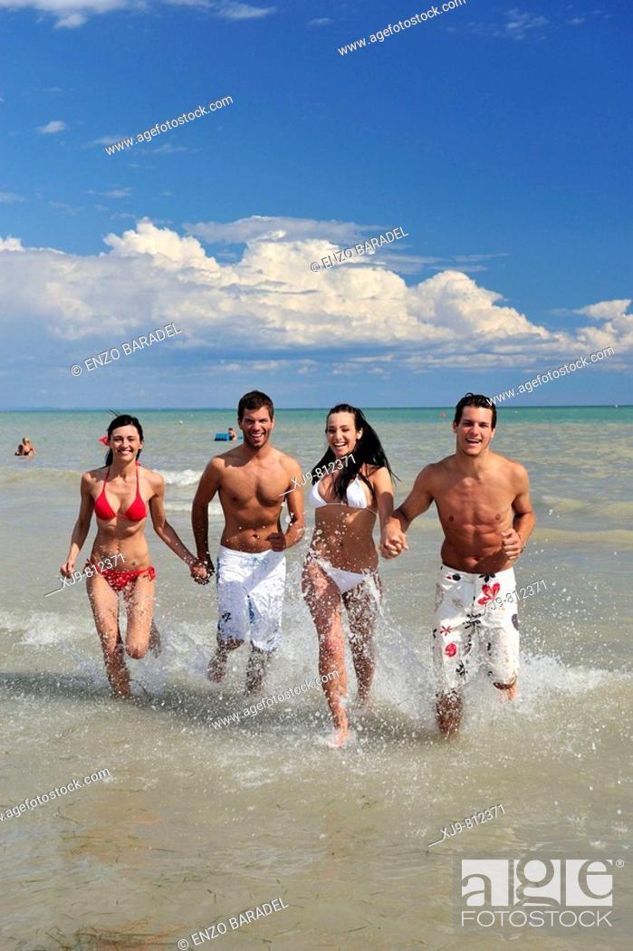 Stock Photo: Boyss running on the beach.