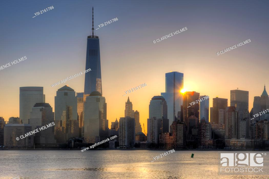 Stock Photo: The sun rises next to 4 World Trade Center as the Freedom Tower 1 WTC stands tall nearby in the World Trade Center complex, in New York City, New York, USA.