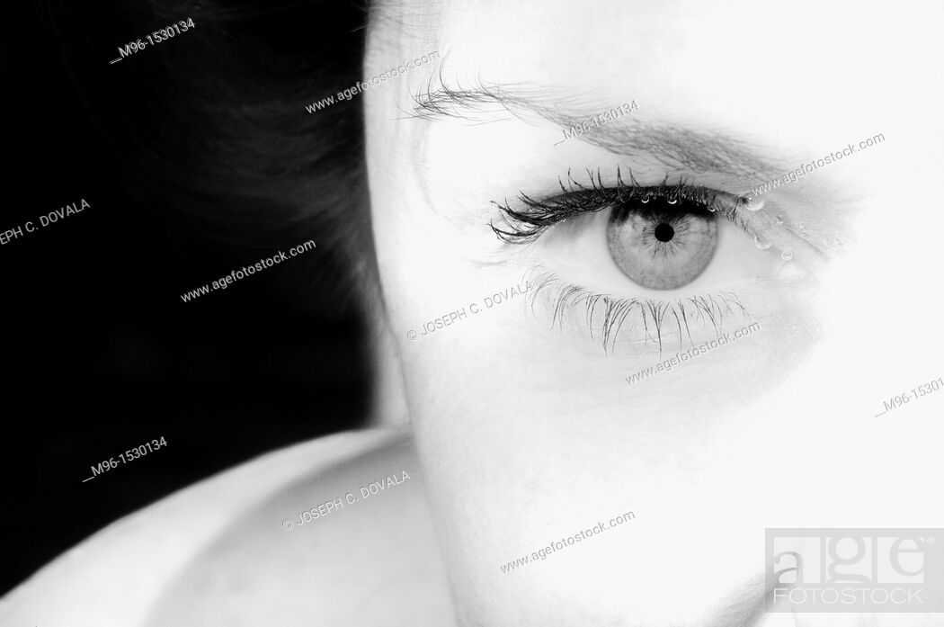 Stock Photo: Woman's eye up close underwater.