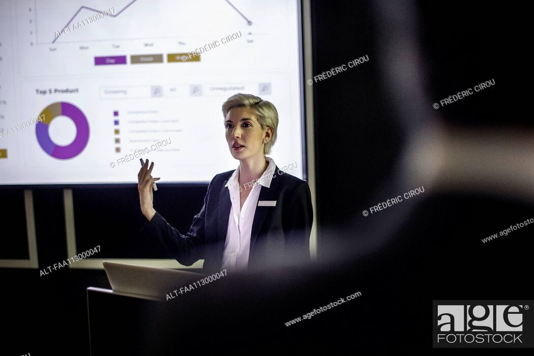 Stock Photo: Woman giving presentation.