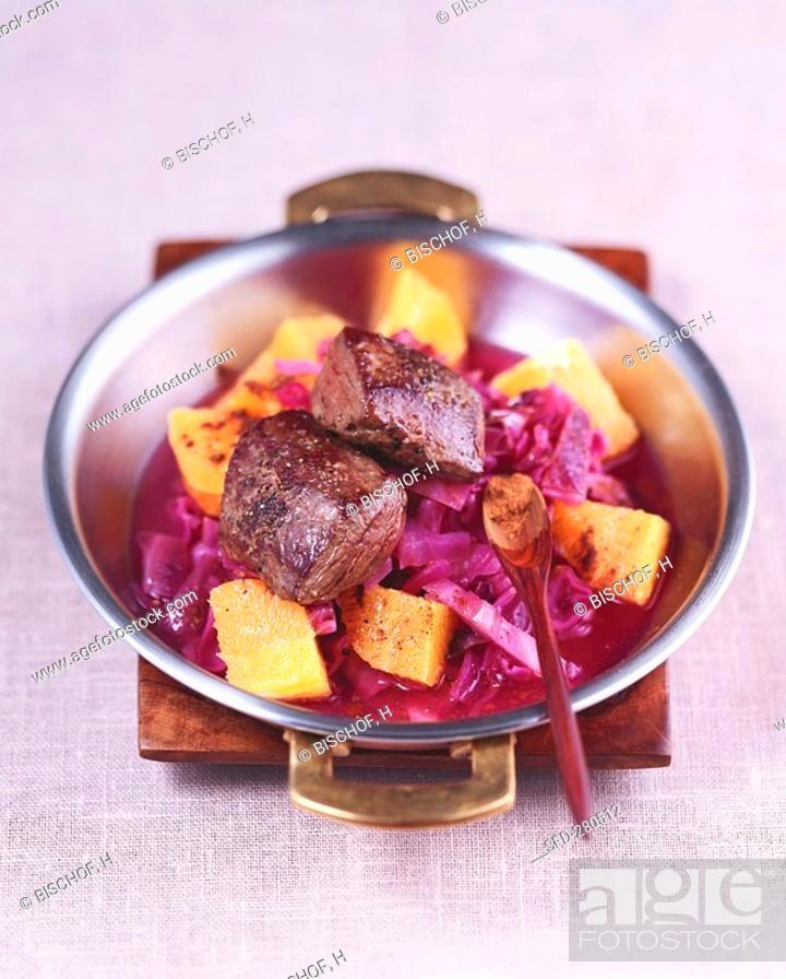 Stock Photo: Venison medallions & red cabbage with orange & cinnamon.