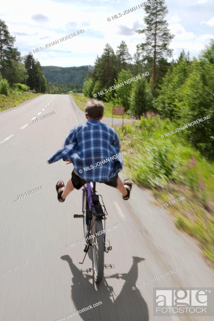 Stock Photo: Boy on bike. North of Sweden.