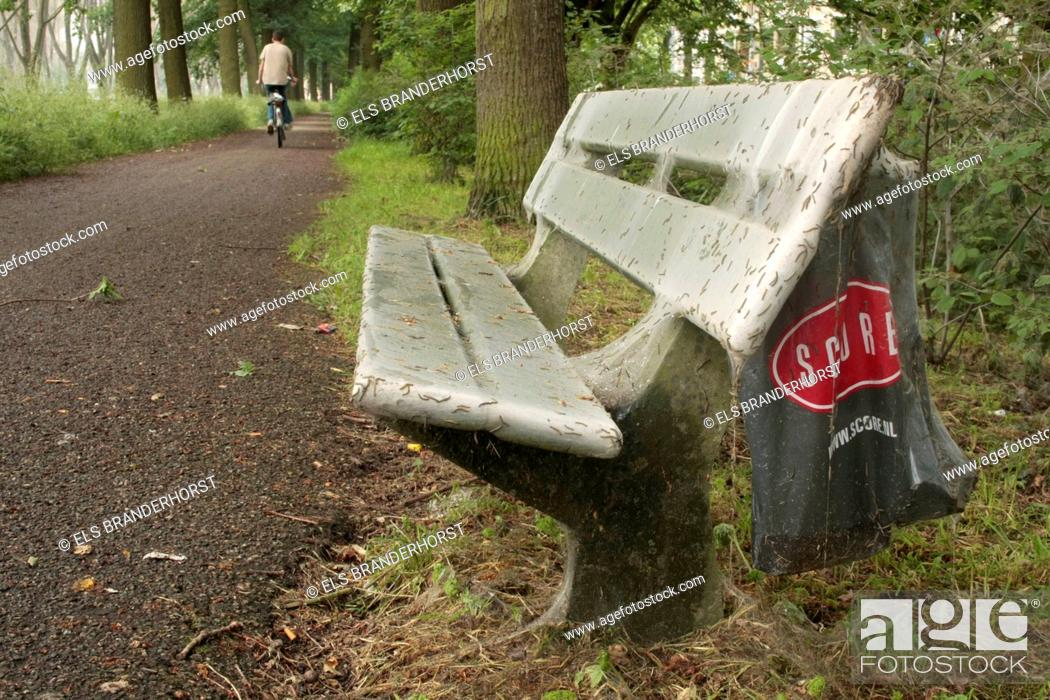 Stock Photo: A bench covered by web of the Ermine moth caterpillar.