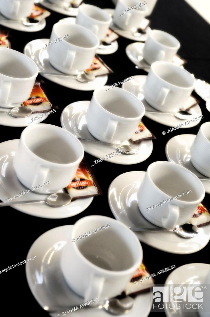 Stock Photo: Cups, spoons and sugar sachets ready to serve coffee.
