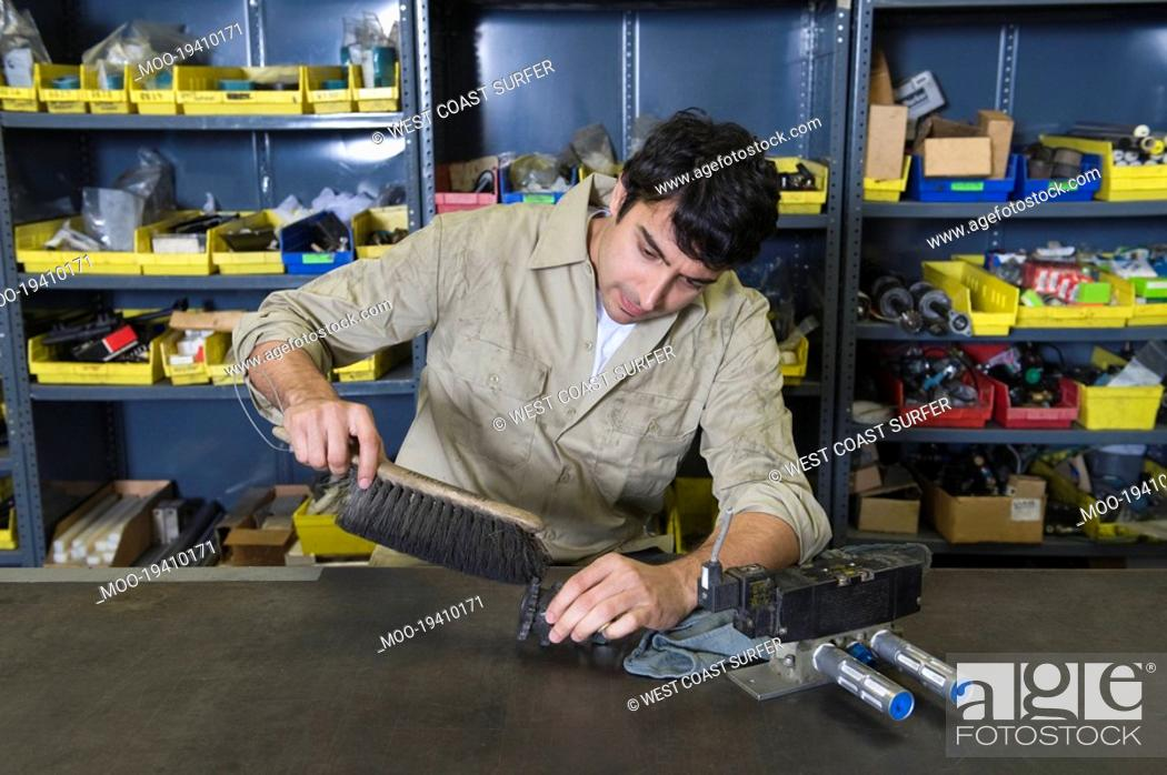 Stock Photo: Man in workshop with tools.