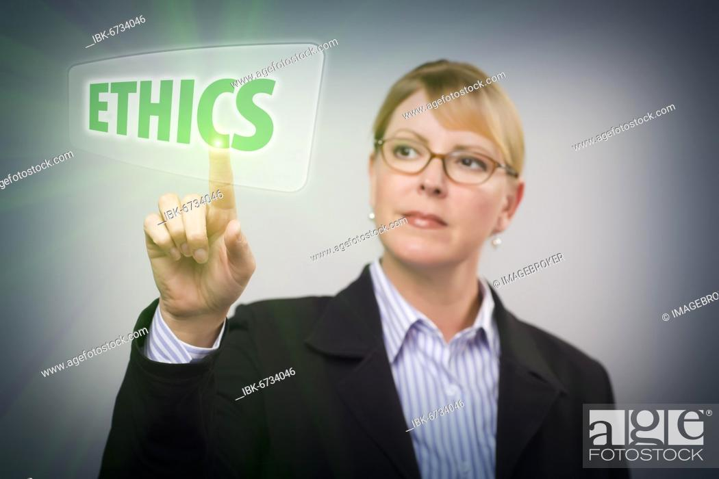 Stock Photo: Attractive blonde woman pushing ethics button on an interactive touch screen.