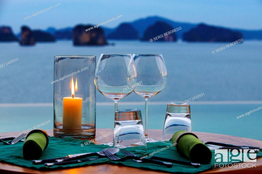 Stock Photo: Six Senses Resort, Koh Yao Noi, Phang Nga Bay, Thailand, Asia. Romantic table in the restaurant near the swimming pool called The Hilltop Reserve in front of.