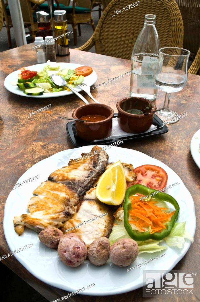 Stock Photo: FOOD LANZAROTE Lanzarotan fish meal lunch Canary potatoes Mojo sauce and salad plate.