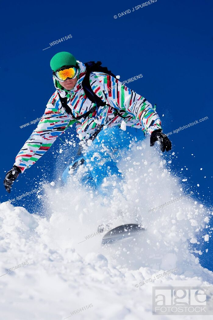 Stock Photo: A Snowboarder riding fast.