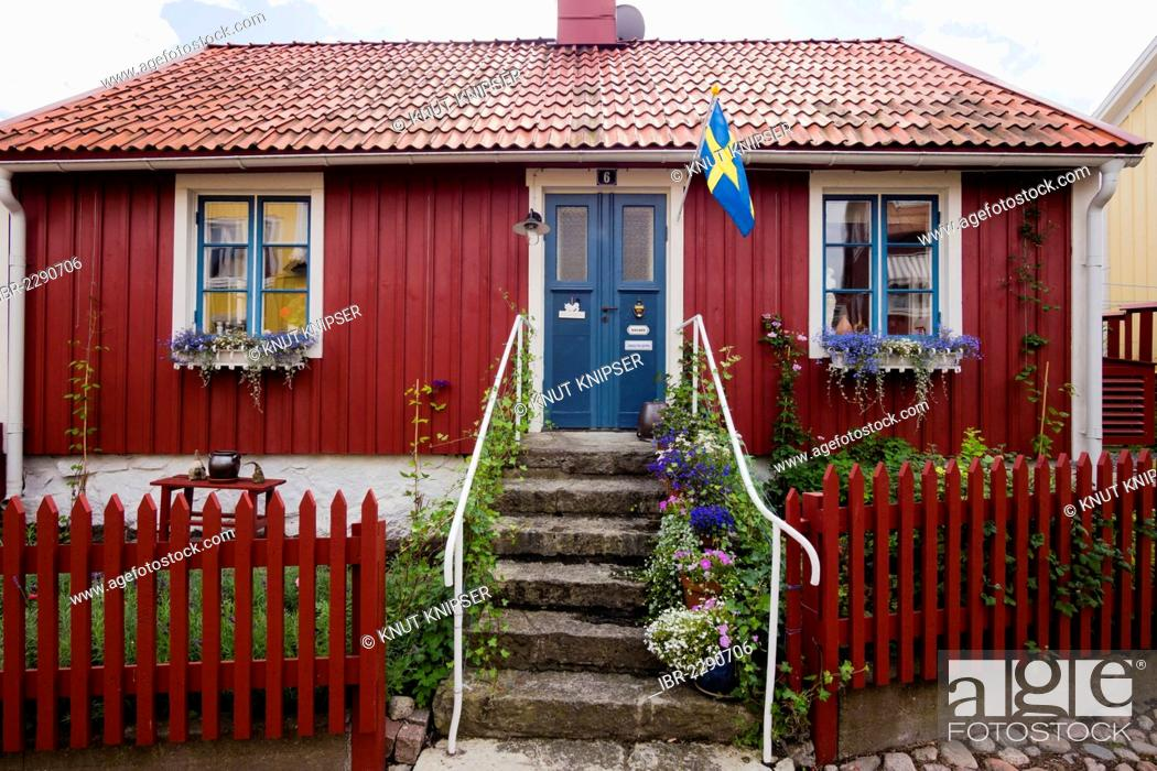 Stock Photo A Typical Swedish House Painted With Traditional Falu Red Paint Besvaersgatan Old Town Lane In Oskarshamn Kalmar Laen Småland Sweden