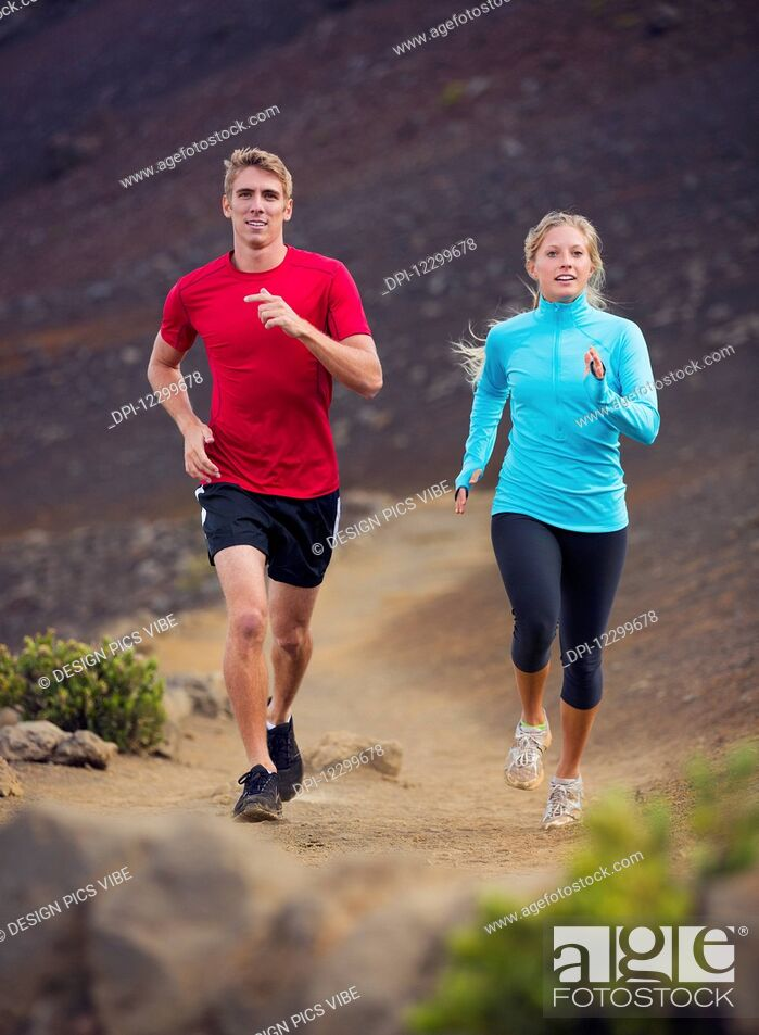 Stock Photo: Fitness sport couple running jogging outside on trail.
