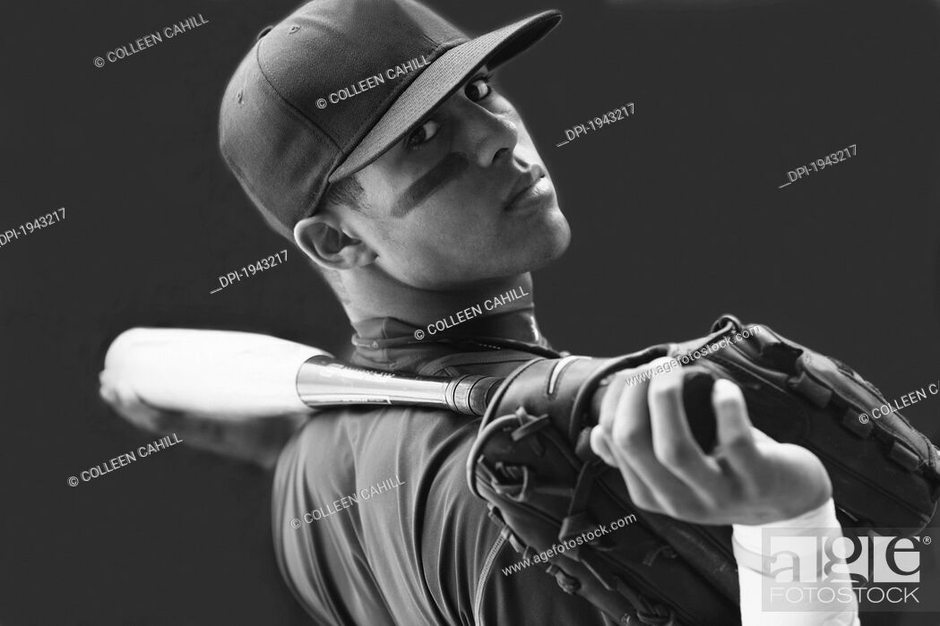Stock Photo: a teenage boy holding a baseball mitt and bat and wearing a cap, troutdale oregon united states of america.