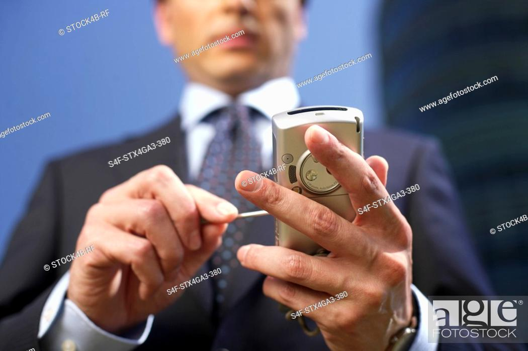 Stock Photo: Person using a cellphone.