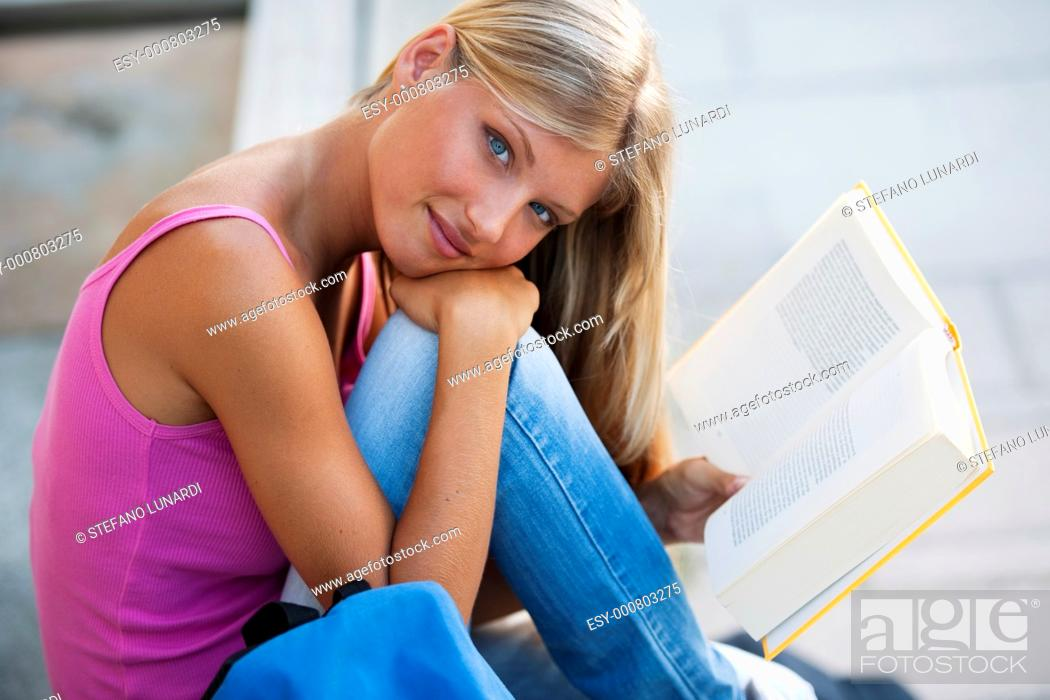 Stock Photo: Beautiful student studying outdoors.