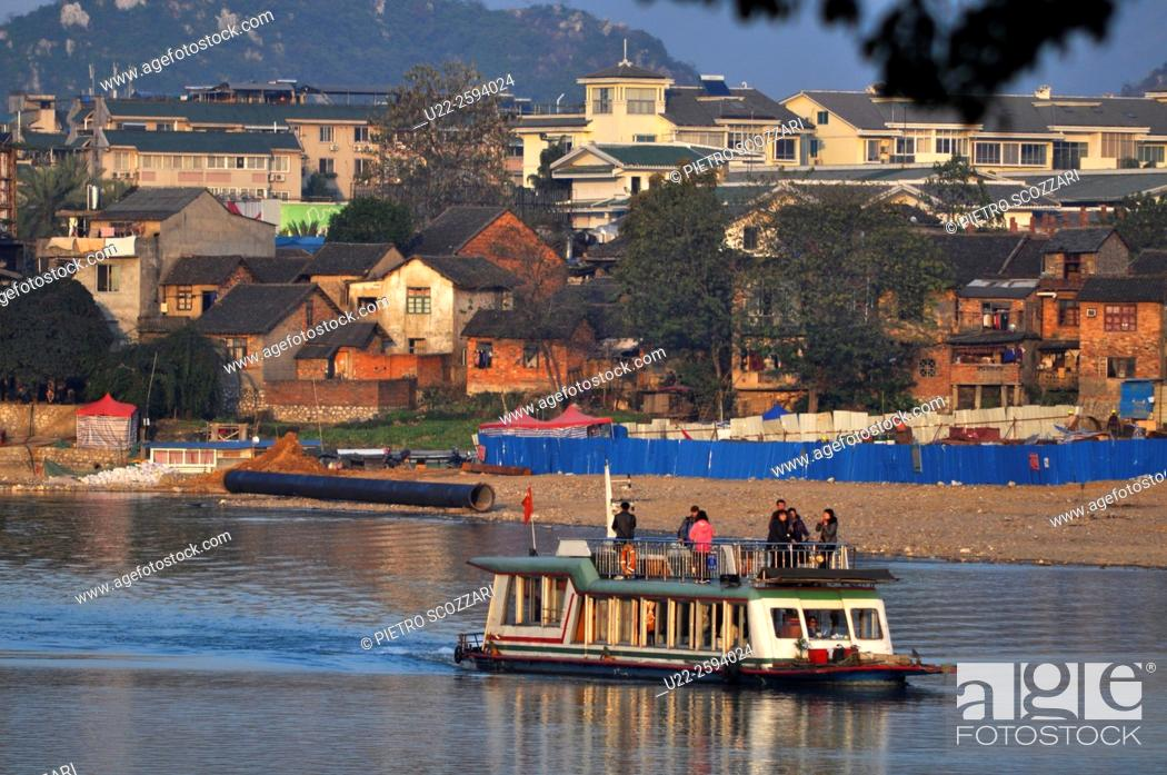 Stock Photo: Guilin, China, boat for tourists along the Li River.
