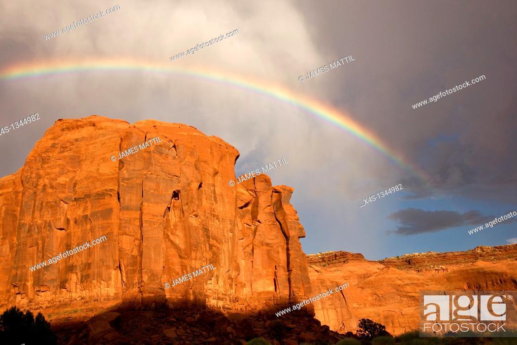 Stock Photo: Rainbow arches above massive sandstone cliffs.
