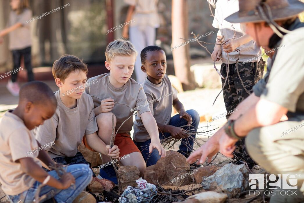 Stock Photo: Children learning how to make a fire.