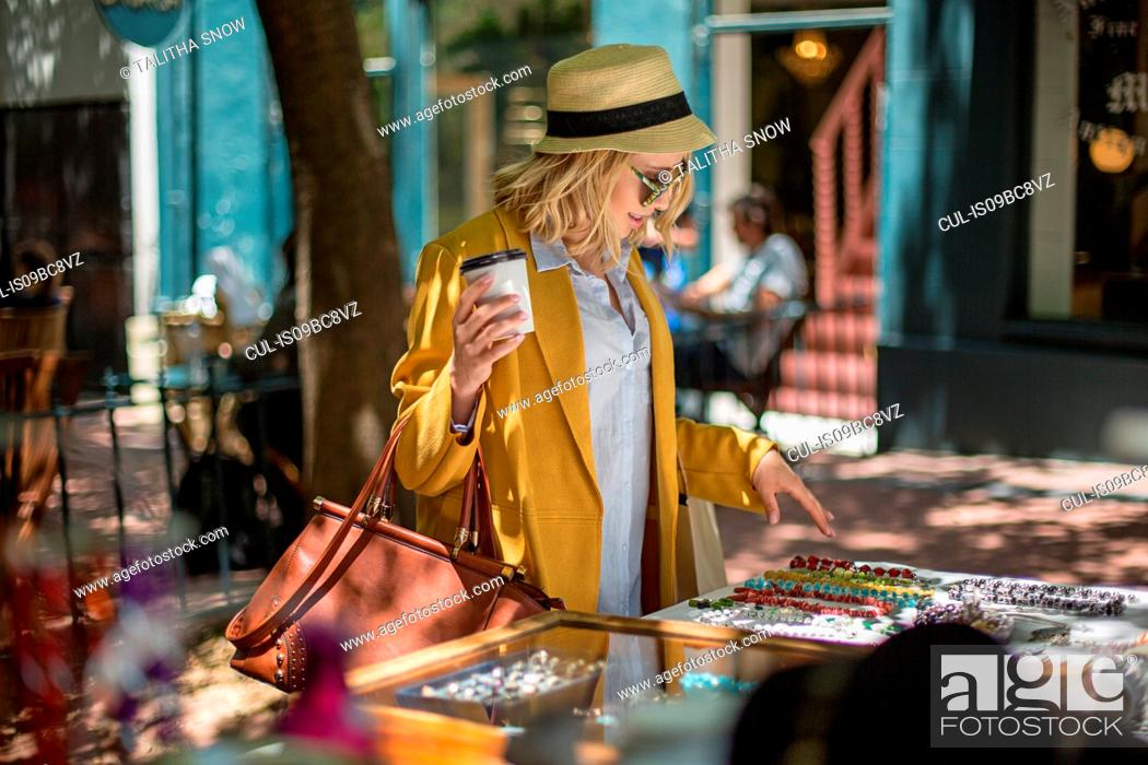 Stock Photo: Woman at outdoor market stall, Cape Town, South Africa.