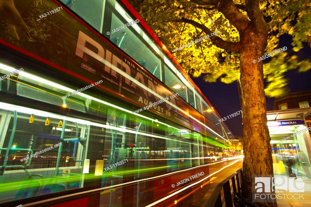 Stock Photo: England, Greater London, London Borough of Camden  Red London bus outside the London King's Cross railway station and St Pancras underground station.