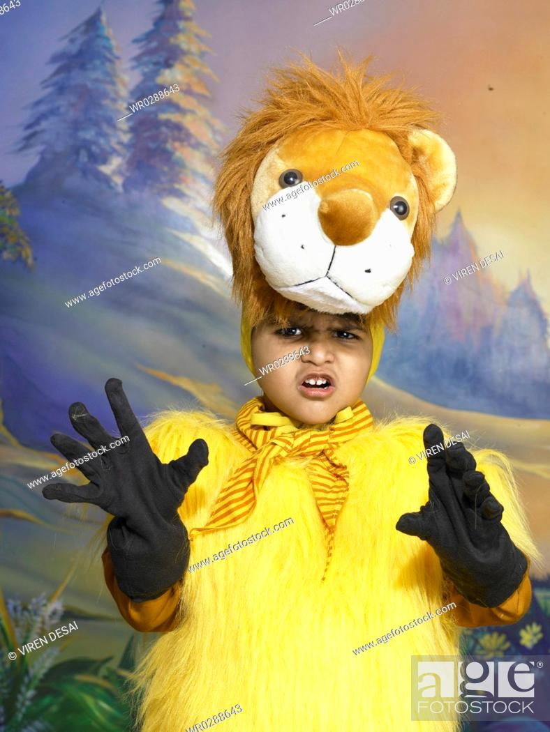 e1019b0dbc Stock Photo - South Asian Indian boy dressed as lion performing fancy dress  competition on stage MR