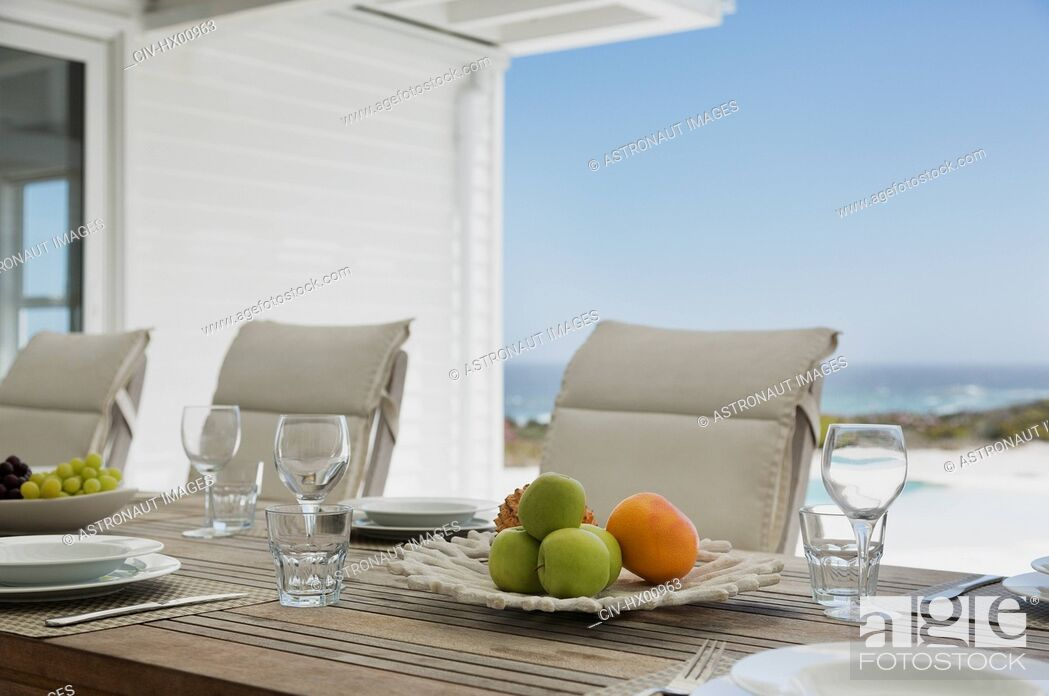 Stock Photo: Placesettings on beach house patio table.