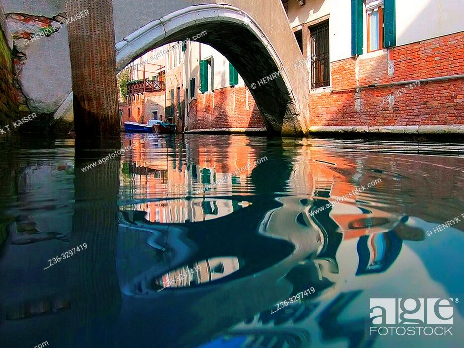 Stock Photo: View on Venetian canal from water surface, Italy.