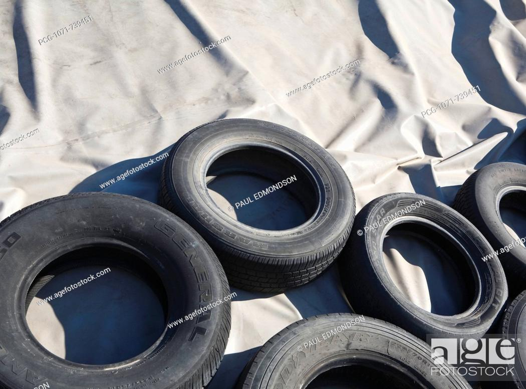 Stock Photo: Tires and Tarp Covering a Pile.