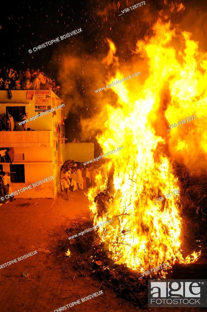 Stock Photo: India, Uttar Pradesh, Holi festival, colour and spring festival celebrating the love between Krishna and Radha, Holika Dahan: the Holi bonfire.