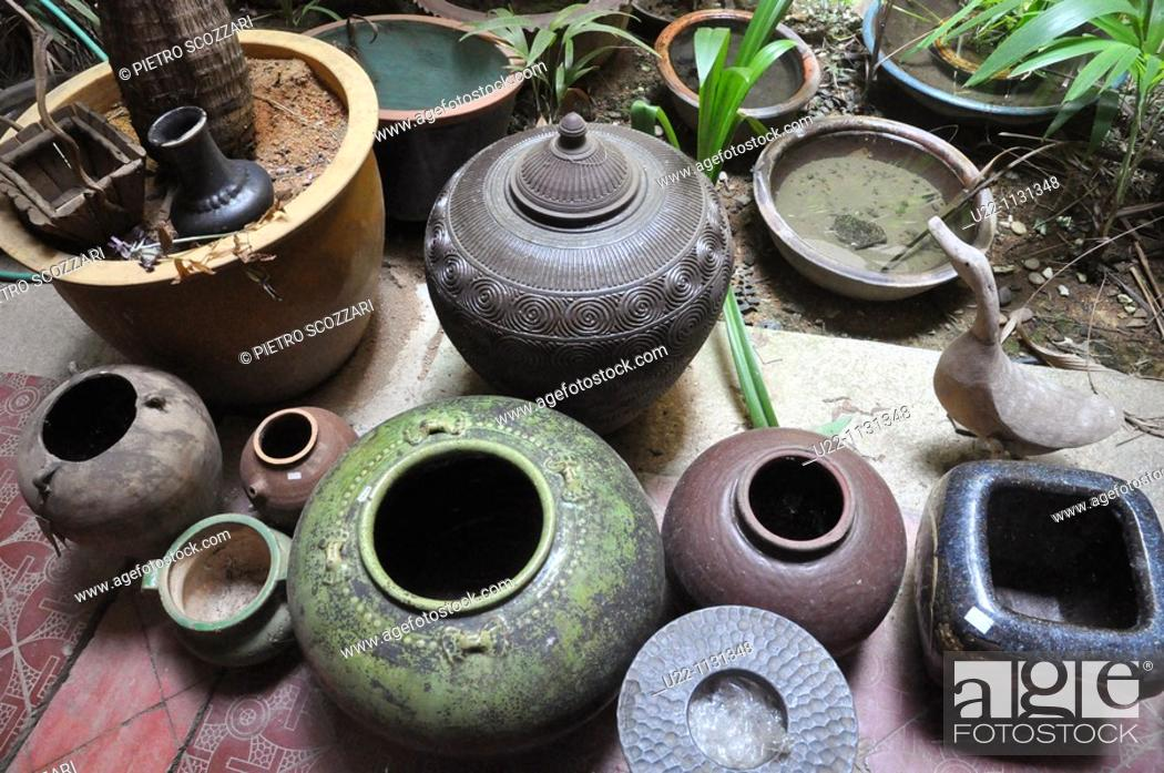 Stock Photo: Malacca (Malaysia): old pots sold at Malaqa House antique shop in Chinatown.