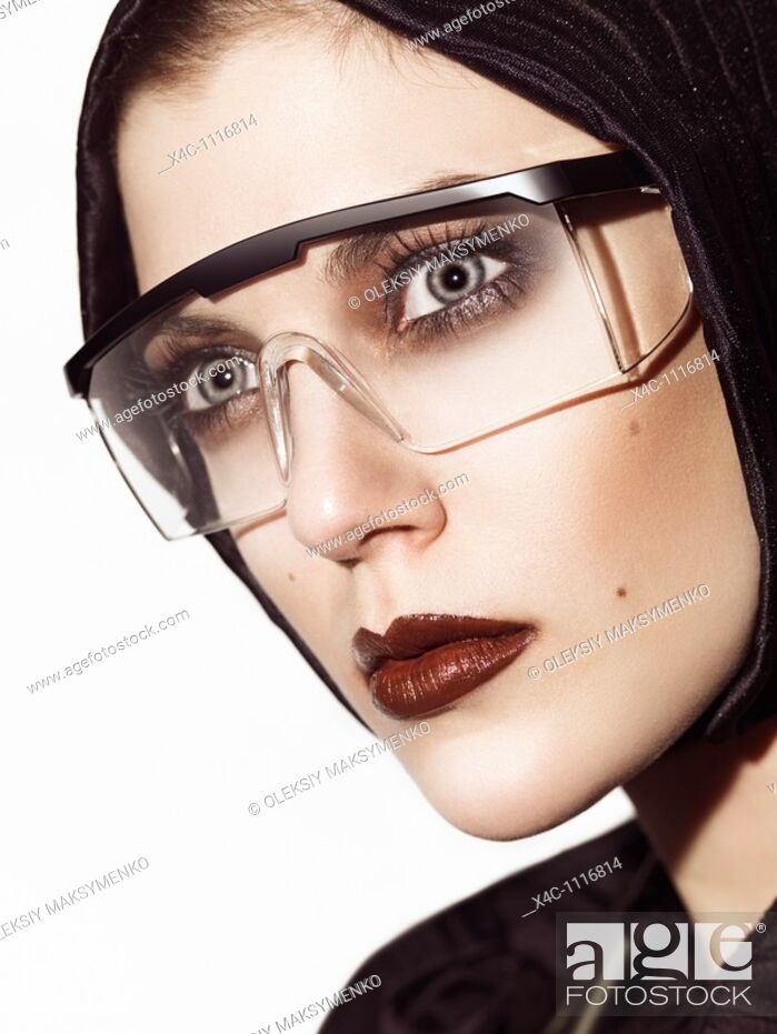 Stock Photo: Headshot of a young beautiful woman wearing eyeglasses  Edgy high fashion photo.