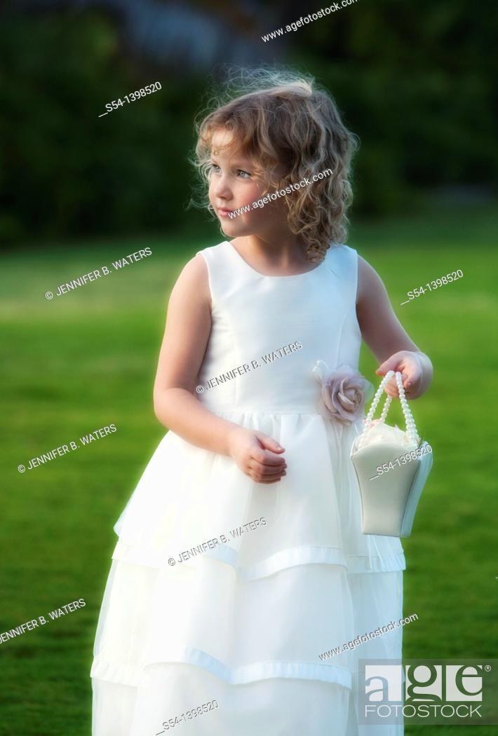 Stock Photo: A flower girl for an outdoor wedding on Oahu, Hawaii, USA.